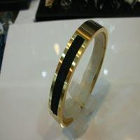 خرید اینترنتی دستبند مردانه استیل اصل طلایی